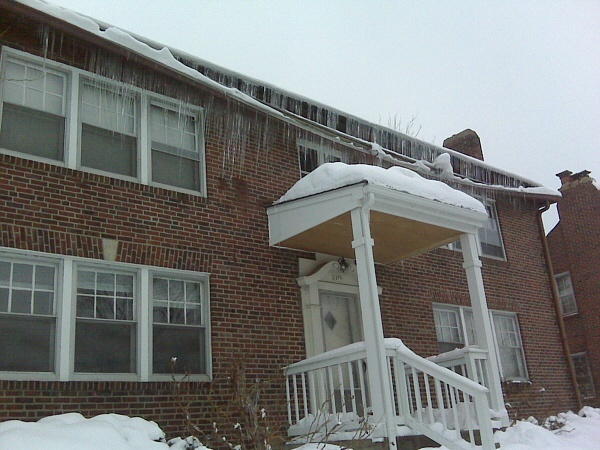 This ice dam was caused from lack of both ceiling insulation and attic ventilation.
